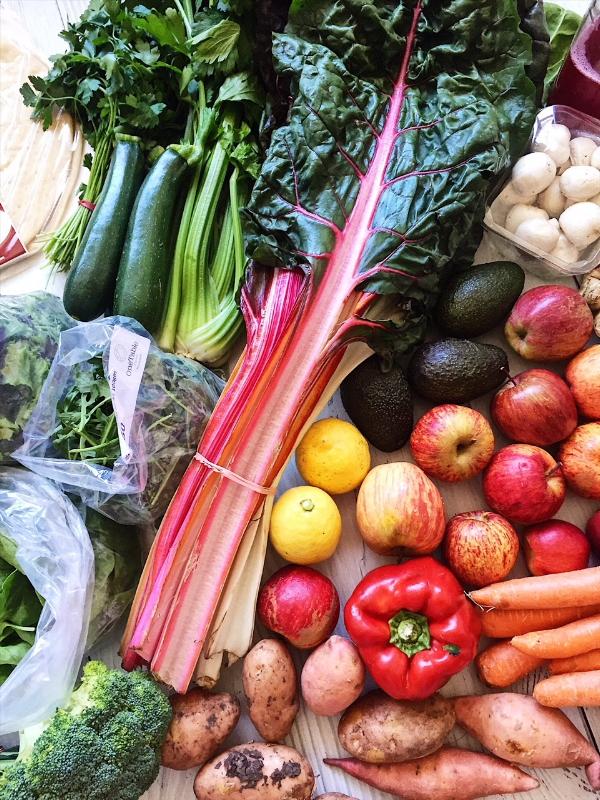 A farmers market shop - zuchini, herbs, celery, swisse chard, mushrooms, avocados, lemons, red pepper, kumara, potatos, apples, rocket, salad, brocolli.