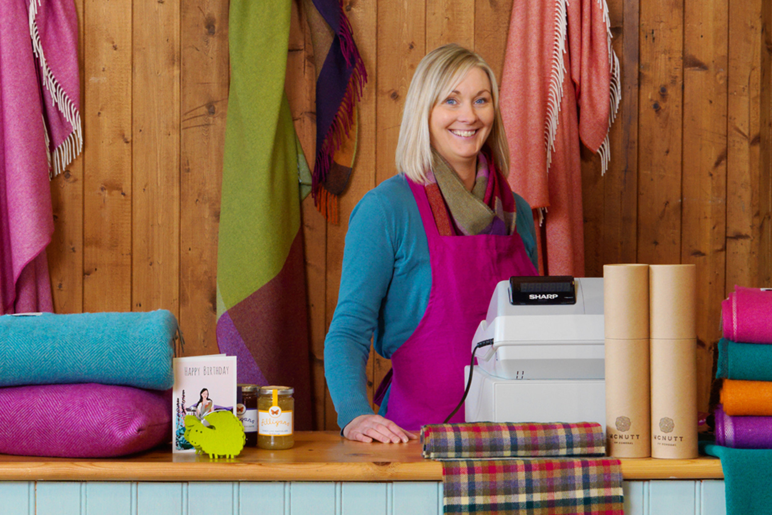 BRONAGH MCGARVEY    Retail Buyer   Bronagh began her position at McNutt of Donegal in 2005 and is our retail buyer for our Craft and Gift Shop, scouting around craft fairs and online shops for the latest Irish made craft and design. Bronagh is also our visual merchandiser for the shop and for our trade shows, ensuring that our product is displayed in the best possible way.Not only does she work in sales at our annual trade fairs, she meets and greets our old and new customers and guides them through the latest season of products.