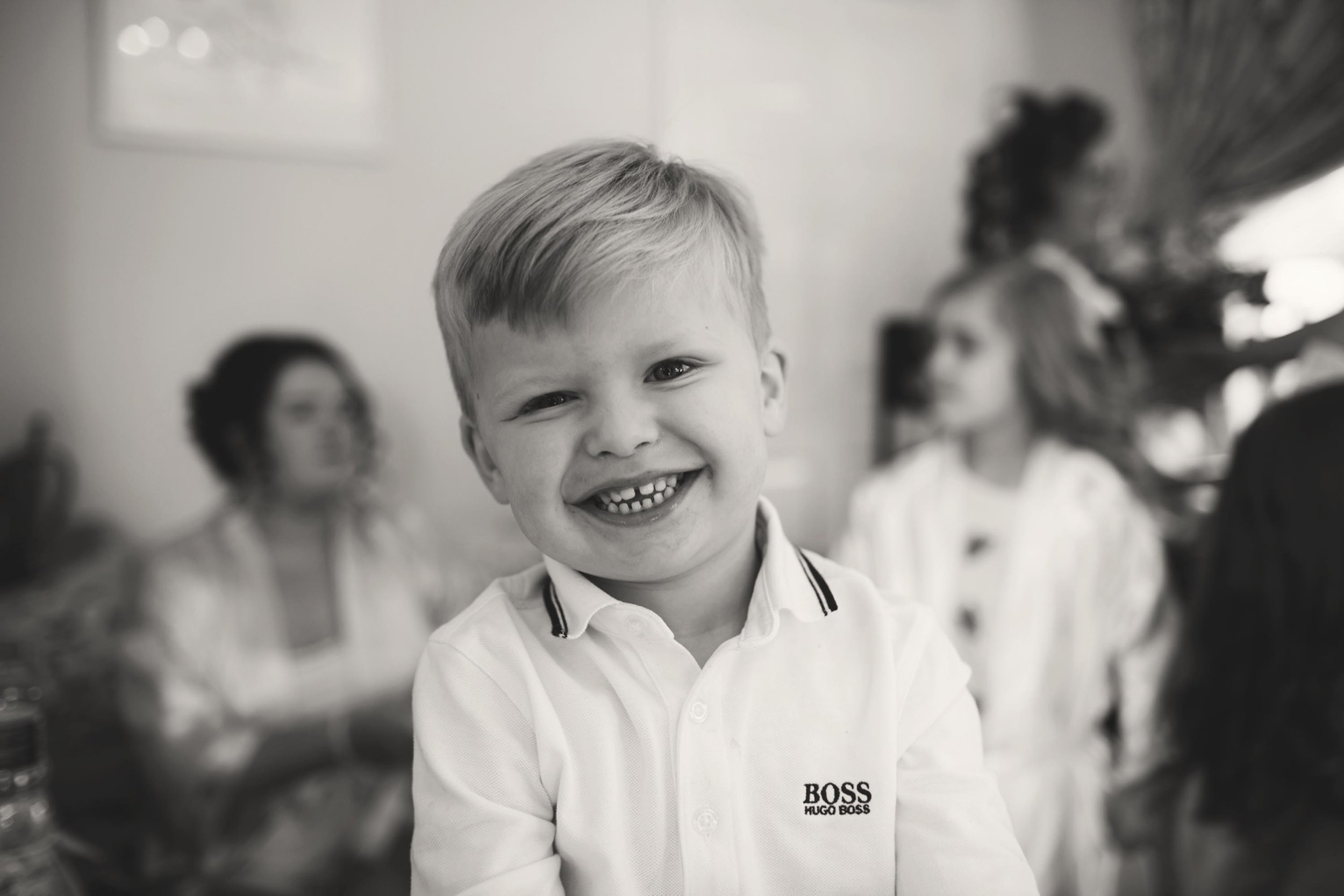 Cheshire wedding photographer bridal prep smiling guest