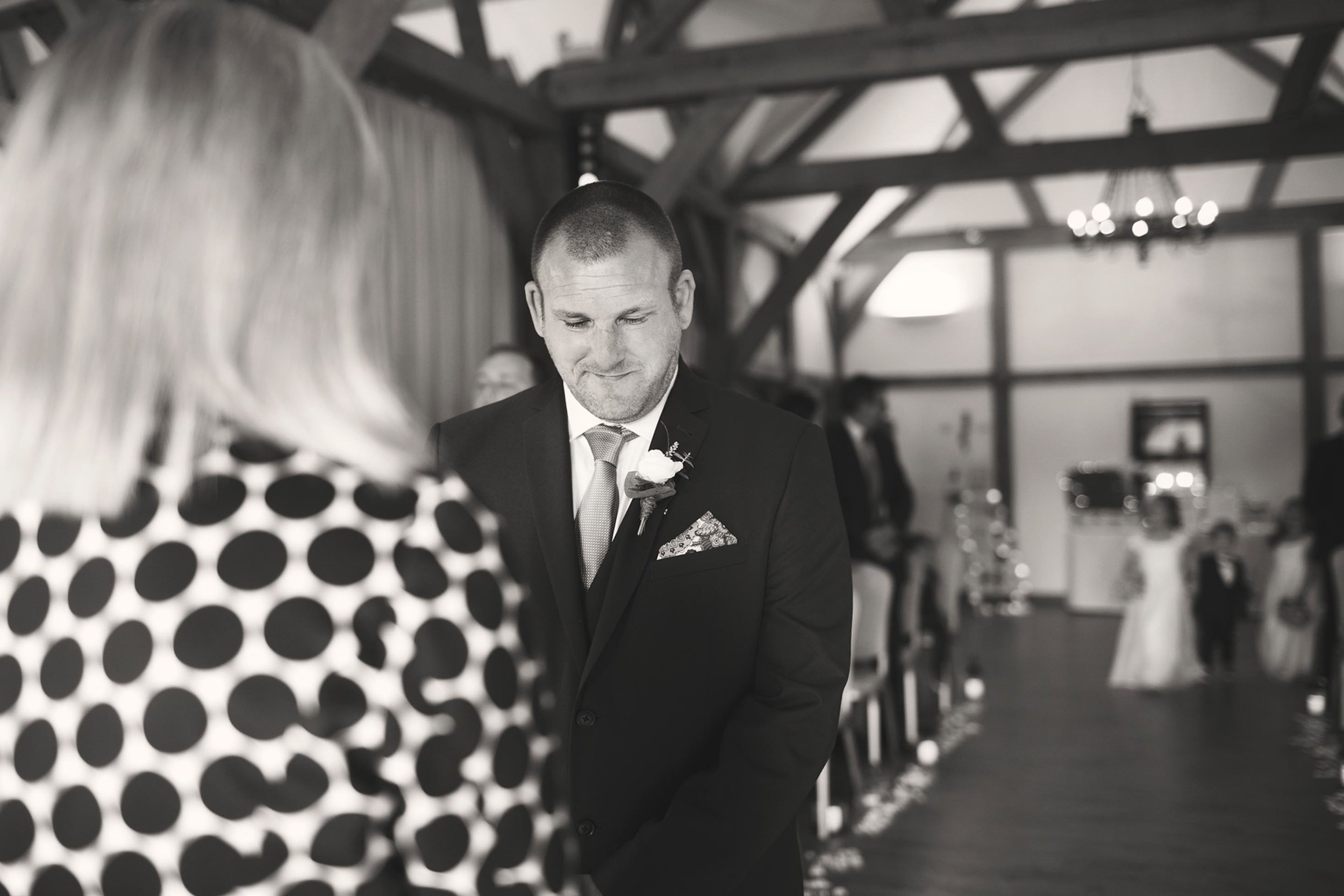 Sandhole oak barn cheshire wedding groom patiently waiting for his bride to be