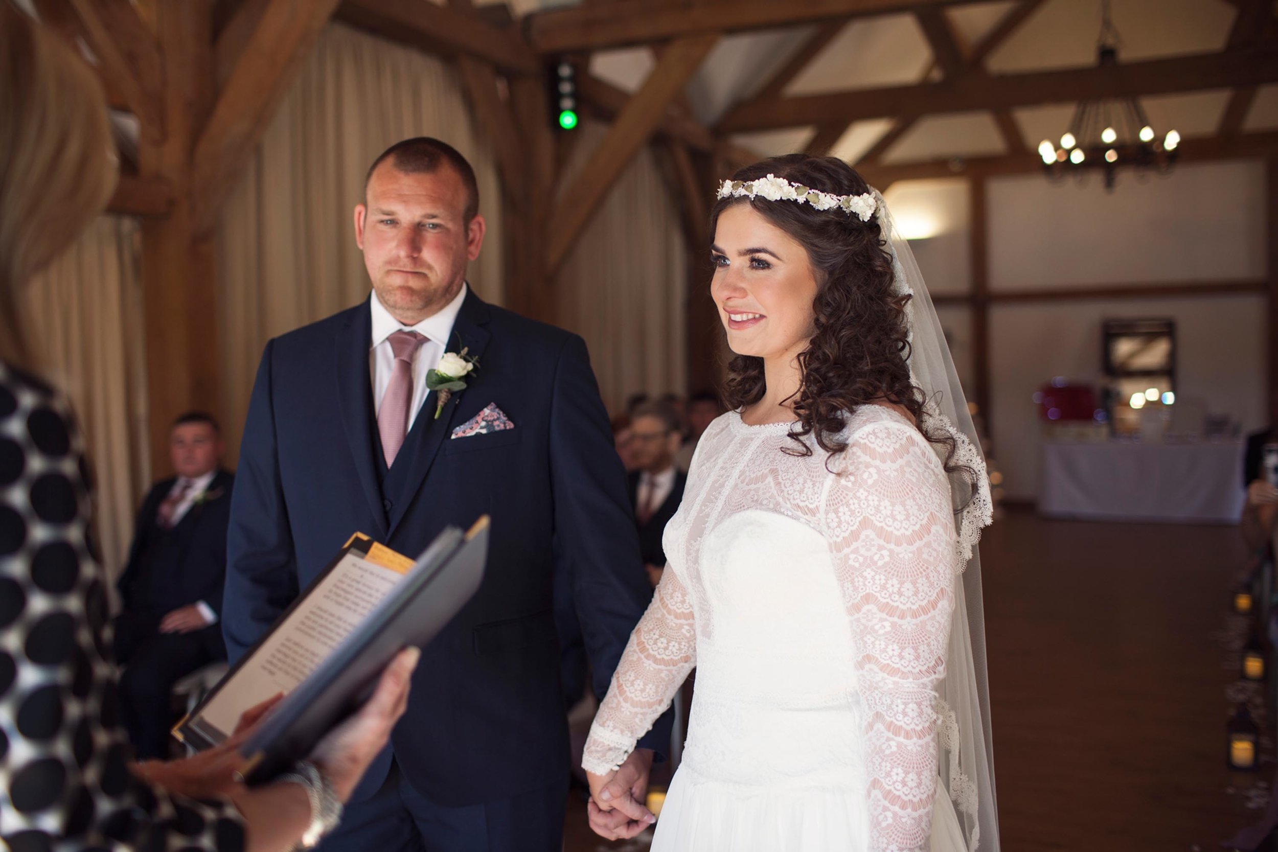 Cheshire wedding photographer smiling and crying vows