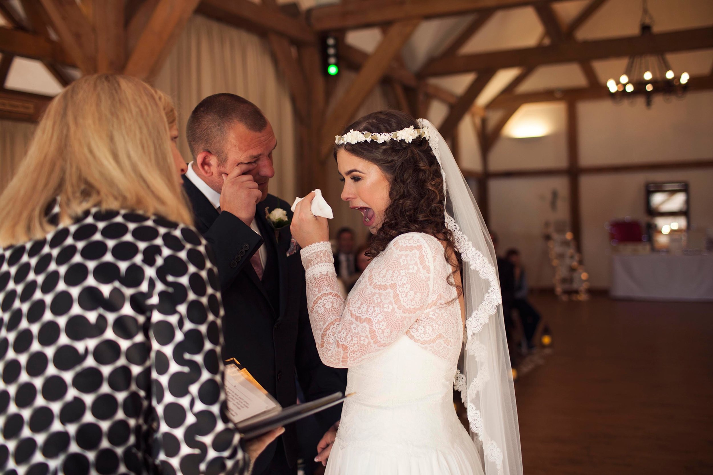 Emotional bride and groom on their wedding day in cheshire laughing and crying