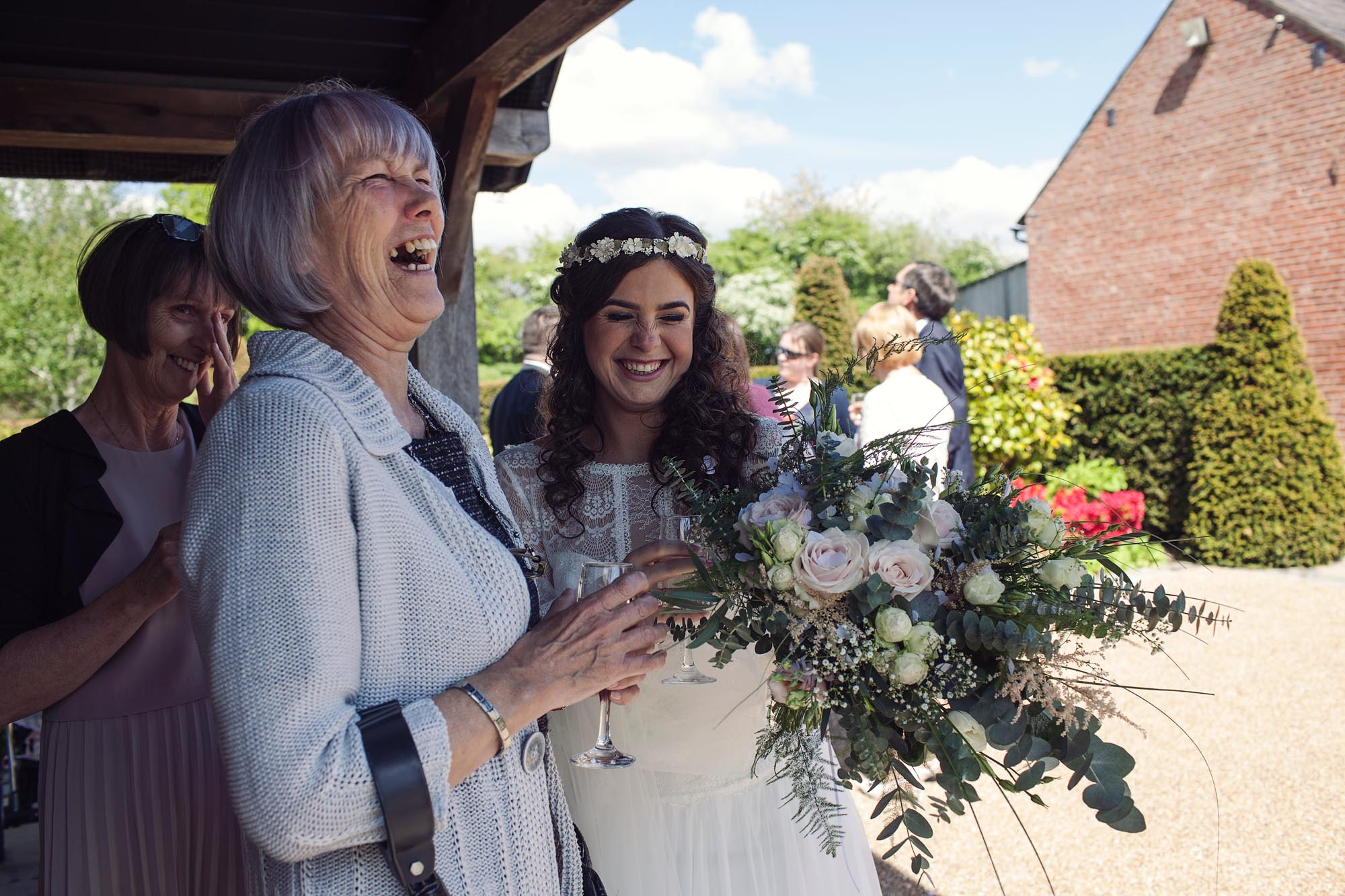 Bride getting guests at her wedding photography