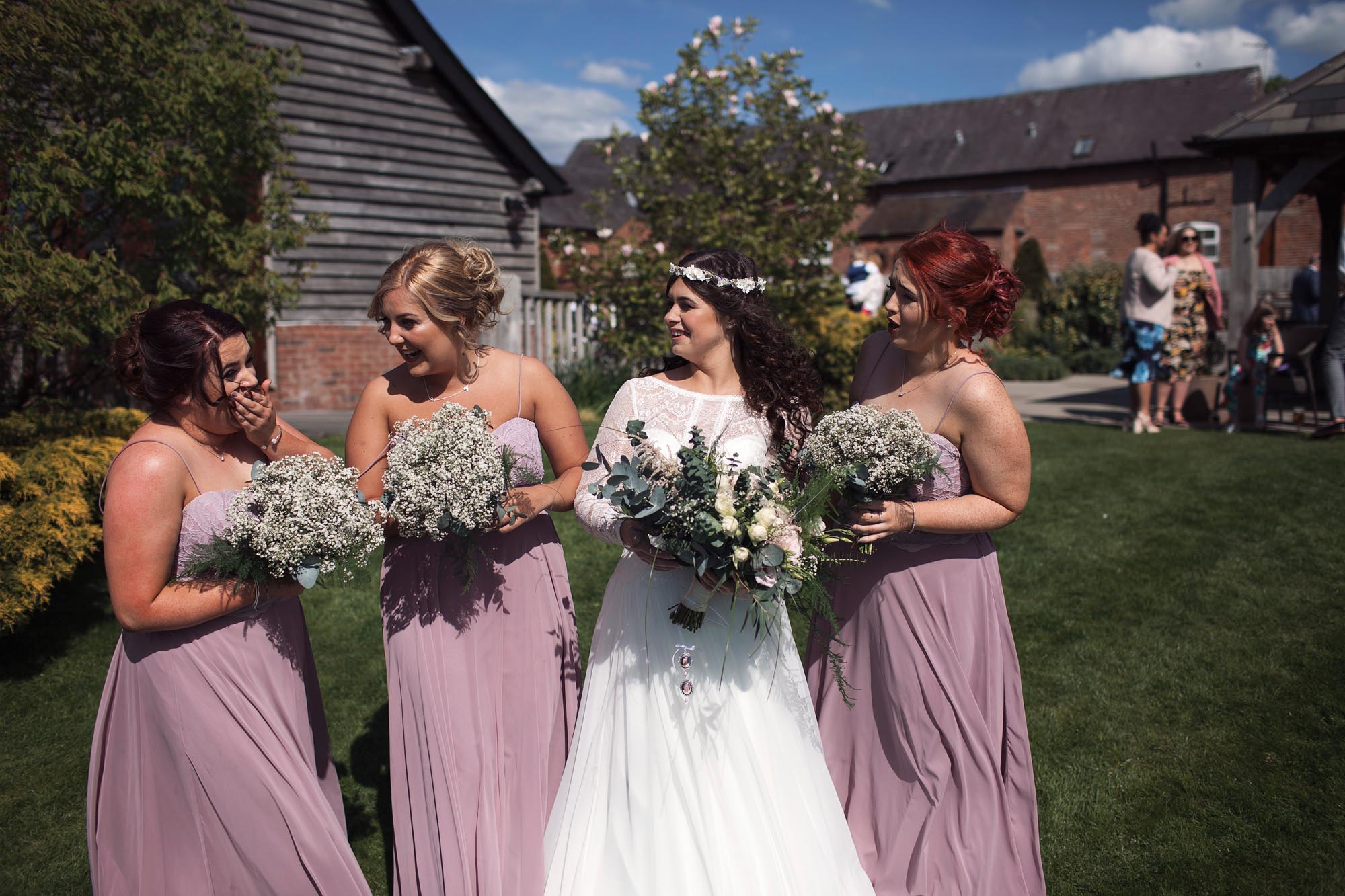 bride and her bridesmaids smiling fun cool laughing wedding happy