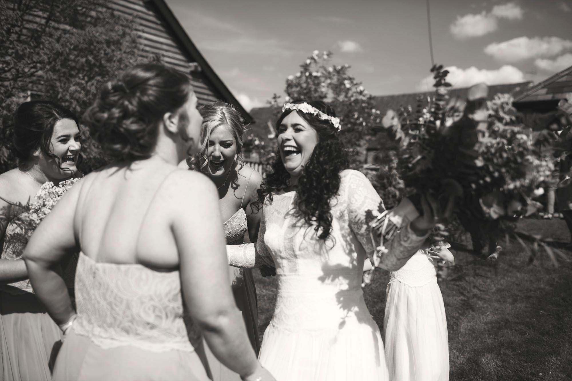 bride laughing joke funny wedding photographer documenting