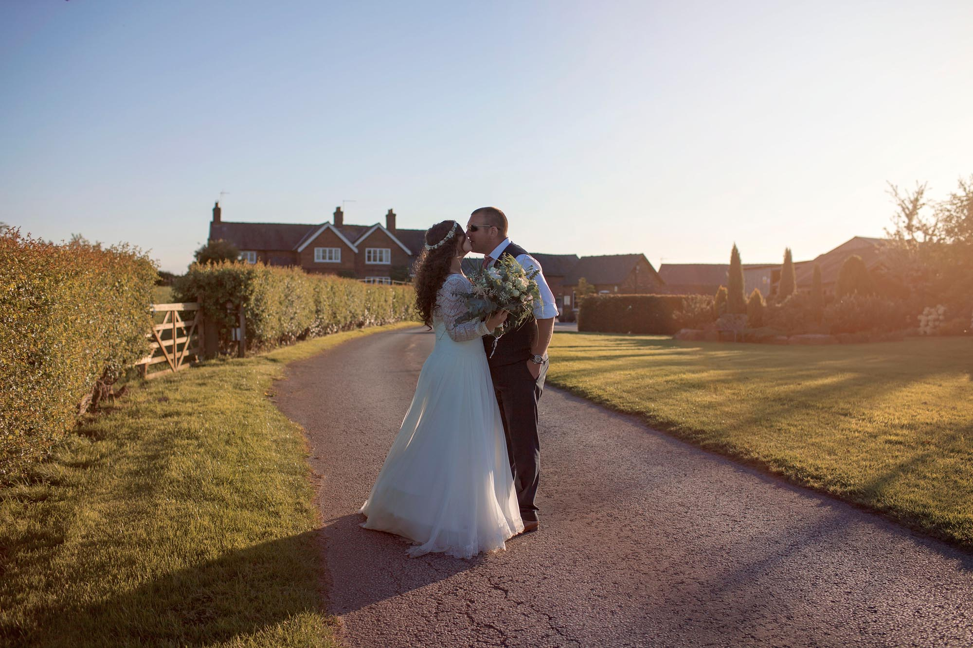 bride and groom in love kissing on their wedding day in cheshire barn wedding