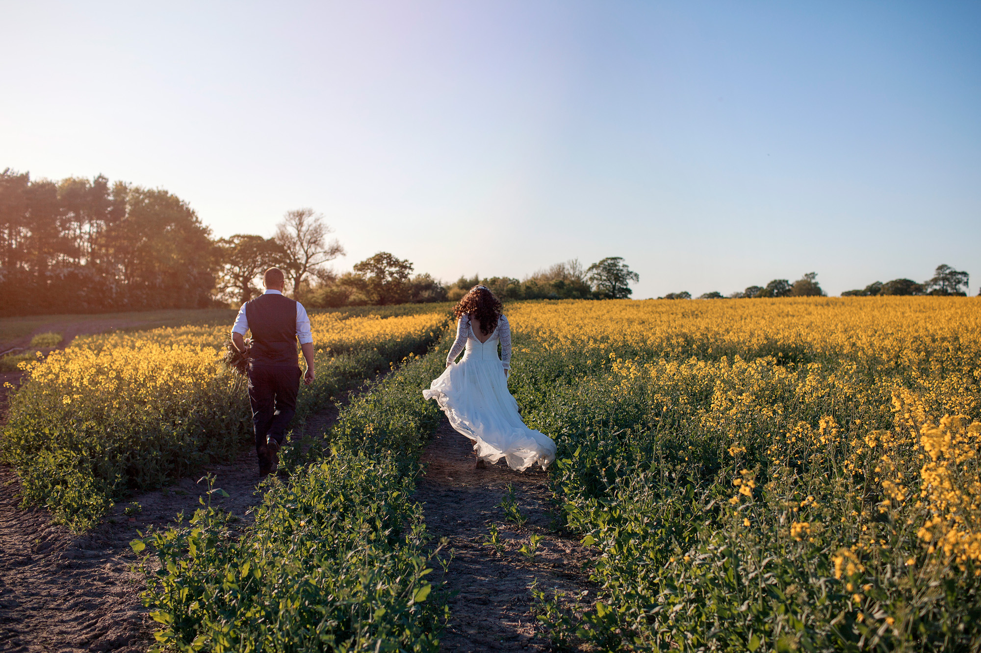 fields of gold in cheshire for bride and groom portraits at their wedding leeds