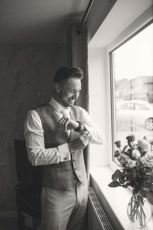 Groom prep in Preston being photographed