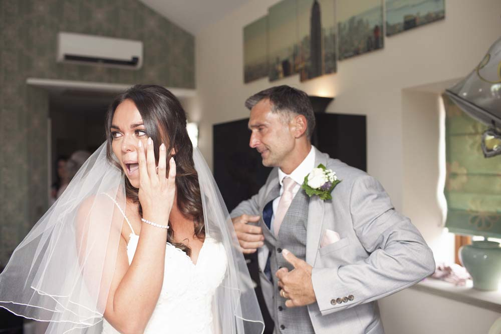 Bride and father of the bride tears on her wedding day photography