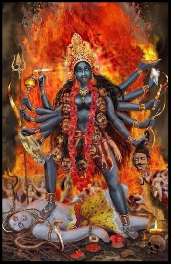 Goddess Kali Ma    stands atop Shiva with a garland of demon heads in the ultimate representation of feminine power.