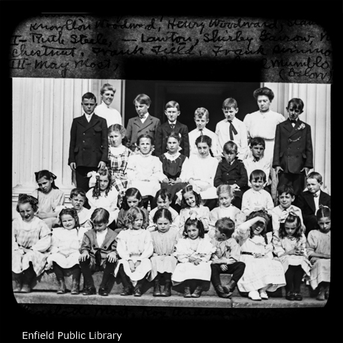 Here is the Junior Department and the Primary Department, or more truly, as many of them as we could get together for  the picture. I will give names from left to right, beginning with the back row.Teachers Present: Miss Mary Parsons. Supt. of the Primary; and Lillian Pease, a teacher.Edward Kingsbury, Fred Simmons, Knowlton Woodward, Henry Woodward, Stanley Adams.Ruth Steele, Miss Lawton, Shirley Garrow, Nellie Chestnut, Frank Field, Frank Simmons,Mary Most, Joseph Mayo, Pearl Mumblo, Charlotte Most, Roy Anderson, Gertrude Whittaker, Marion Jones, Norman Henry, Willie Edgar.Esther Steele, Louise Edgar, John Brown, Doris Field, Laura Burbank, Lillio Most, George Burbank, Maude Frazier, Lillian Brown, Alma Most.