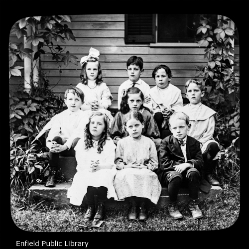 The teacher of this class could not be present. Beginning at the back row.Lillian Brown, Herman Woodward, Roy Anderson.Newman Henry, Miss Most, Joseph Mayo.The first name has escaped me, Laura May Burbank, William Edgar.