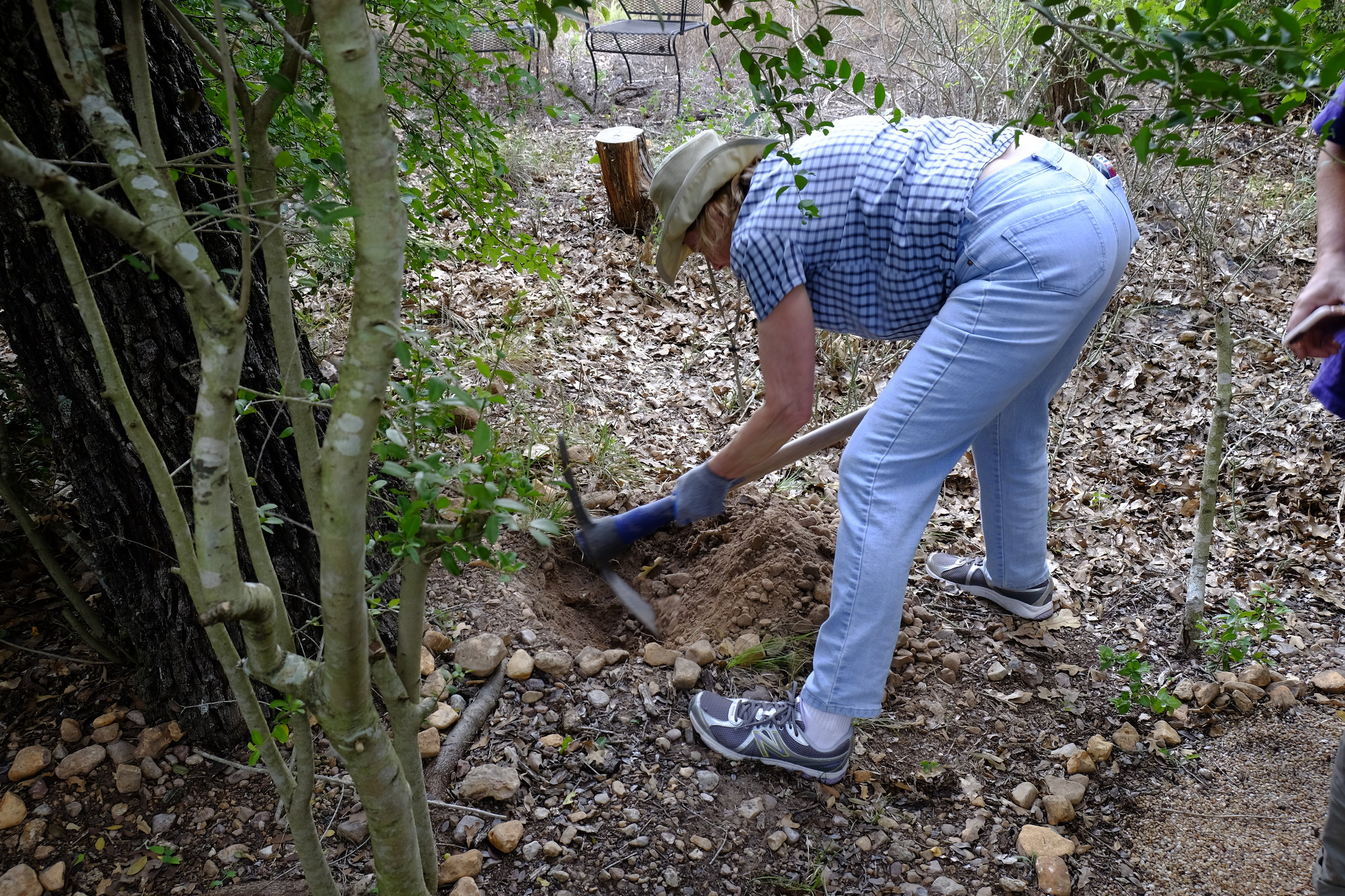 Digging a burial grave at Eloise Woods Community Natural Burial Park.   photo by Tom Bailey