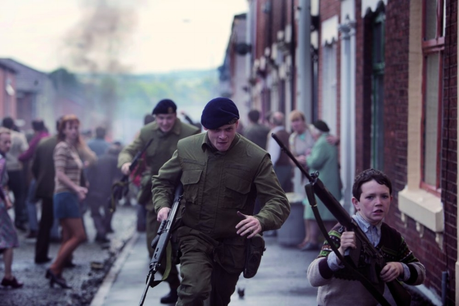 71-2014-001-armed-soldier-and-boy-running-down-street.jpg