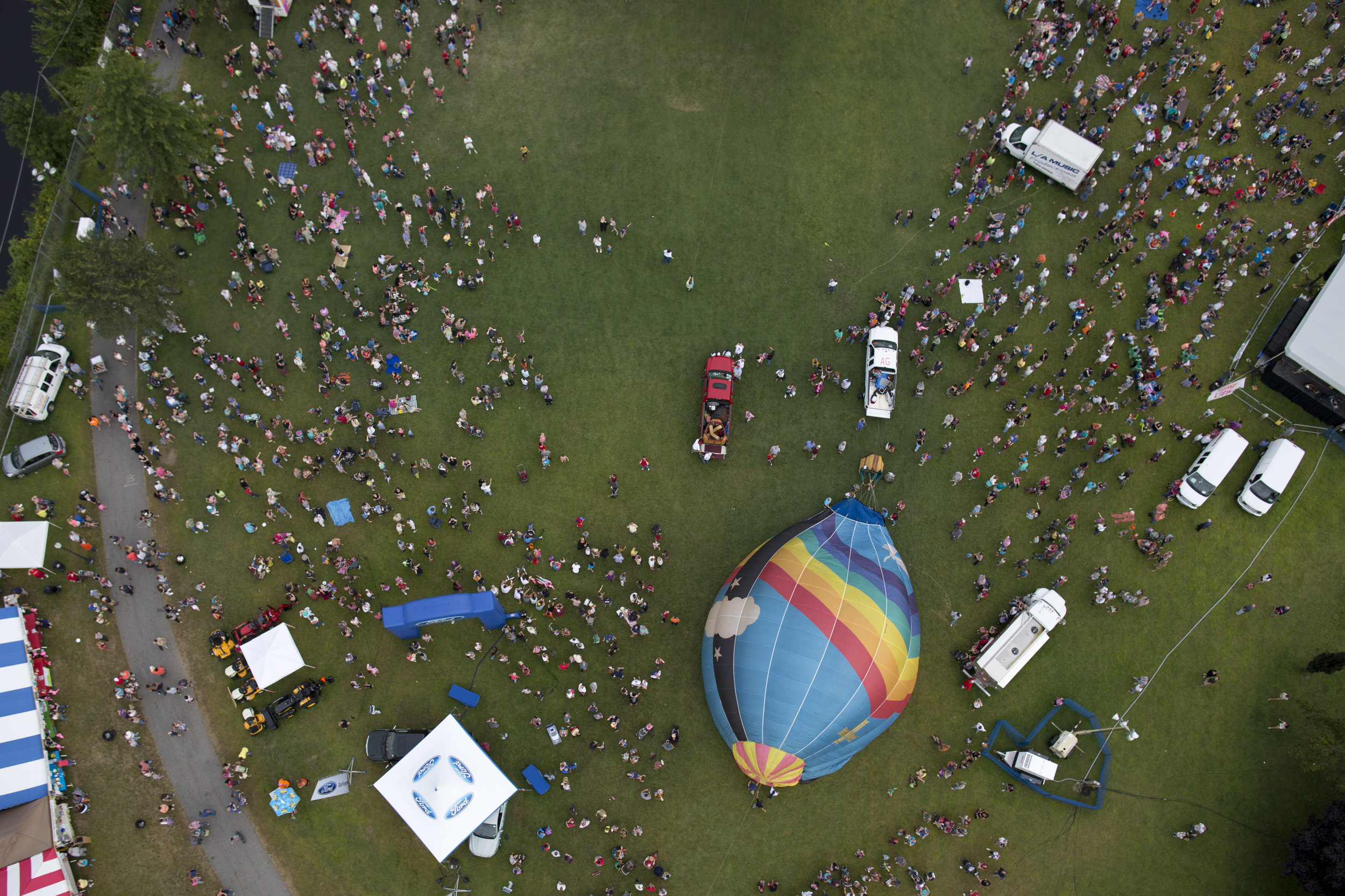 Hot air balloons fly above Lewiston and Auburn, Maine during the Great Falls Balloon Festival on August 18, 2013.