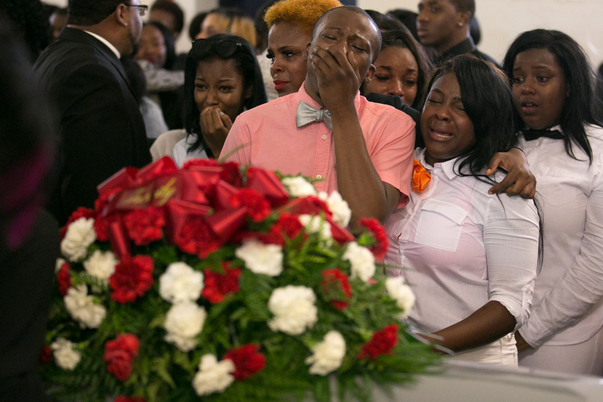 Visitors mourn at the funeral for Jonah Barley in Rochester, N.Y. on Saturday, August 29, 2015. Barley and two others were killed in a drive-by shooting outside the Boys and Girls Club in Rochester on August 19.
