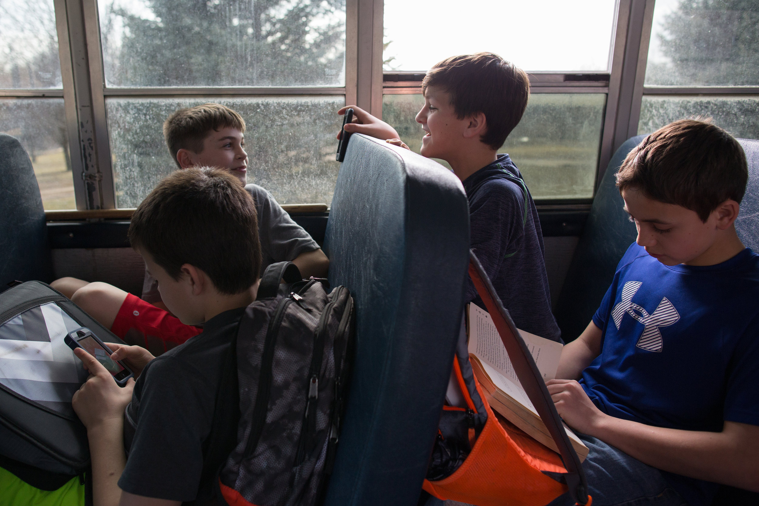 Hayden Taylor, Connor Patrick, Tyler Hancox, and Luke Luu (left to right) ride the bus home from school in Solon, Iowa on Tuesday, March 8, 2016.
