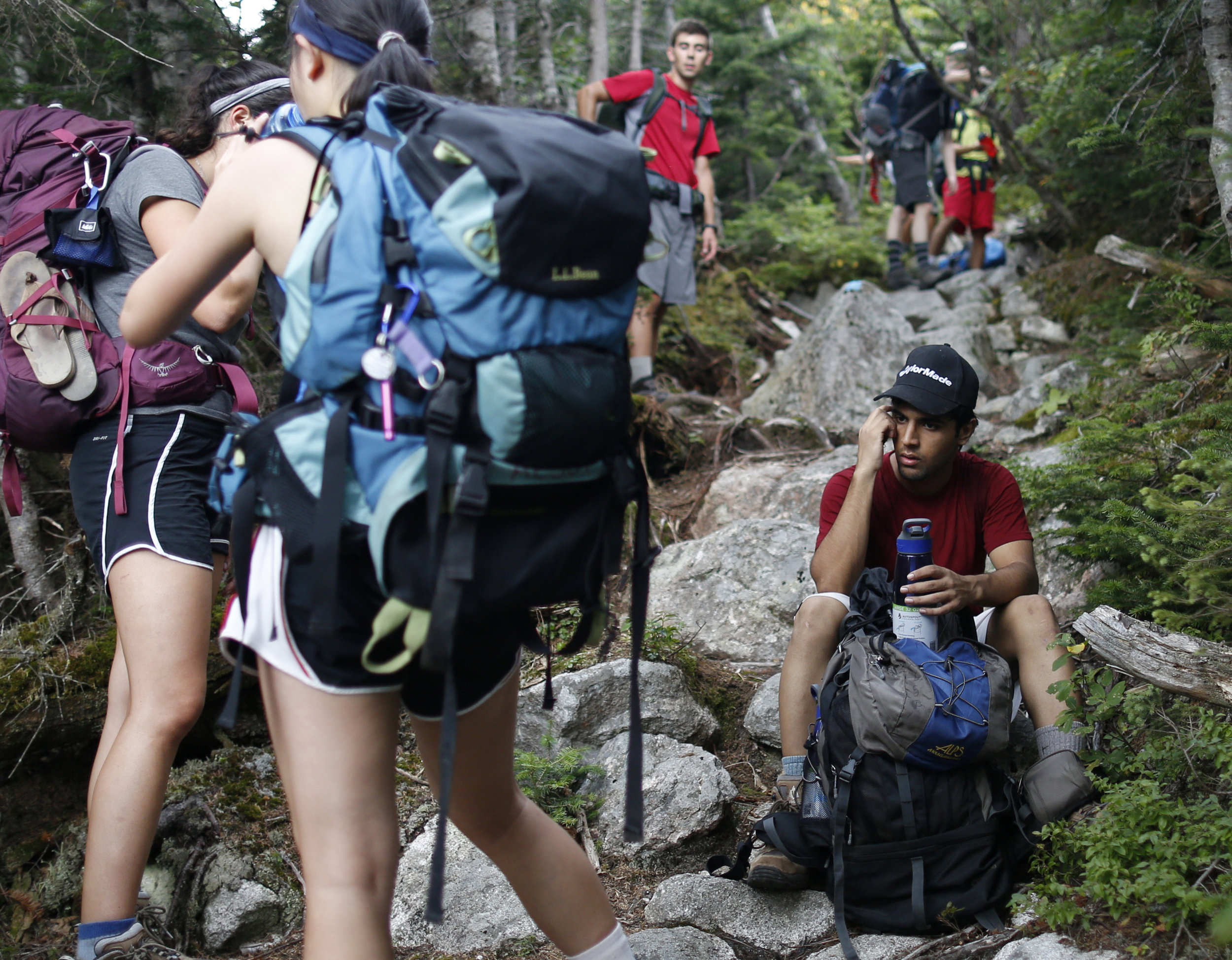 The group pauses for a water break during the hike up Hamlin Peak. Divyamaan Sahoo, right, who had been in the United States less than 24 hours before departing for the trip, was diagnosed with malaria after returning to campus.