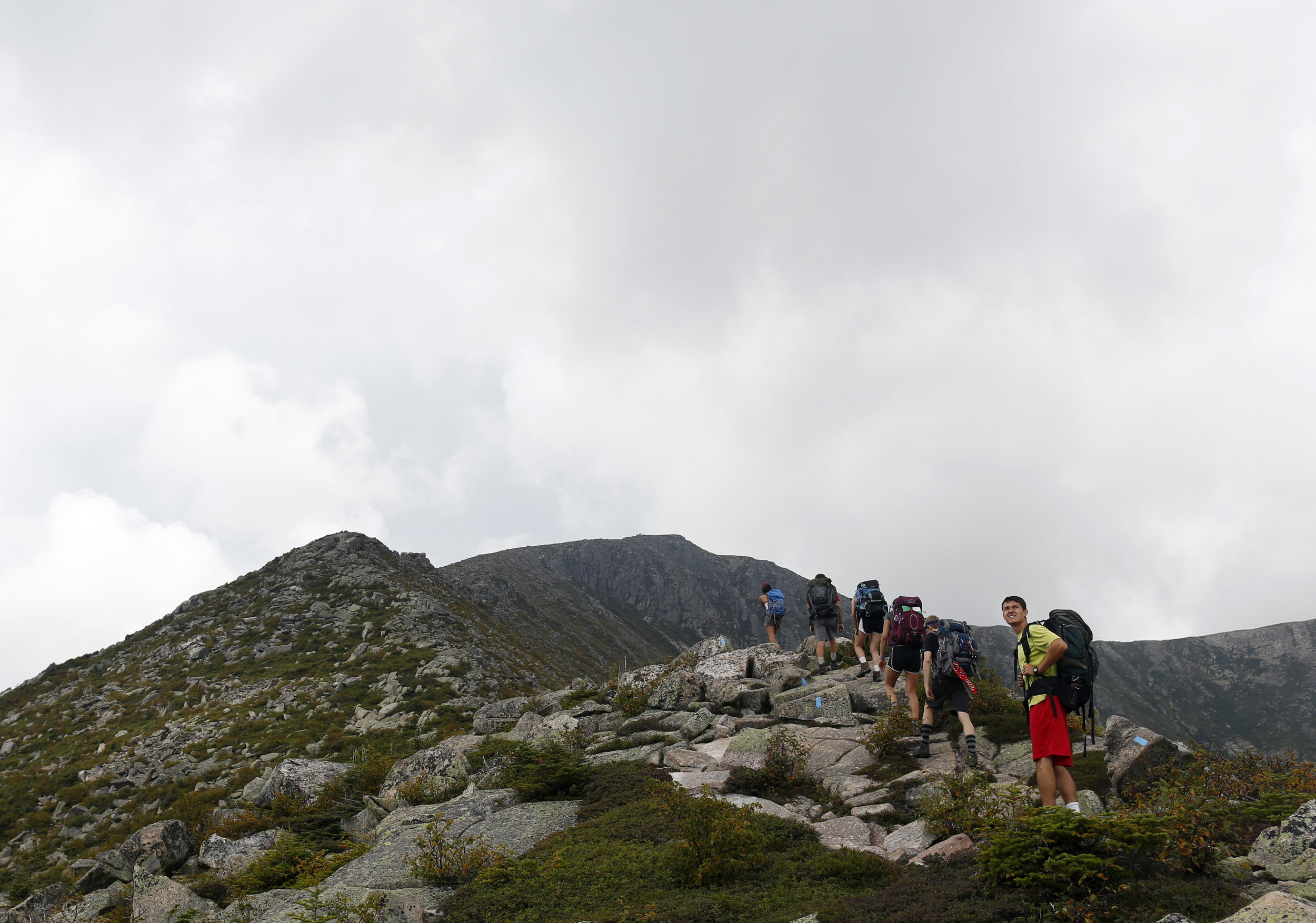 Bobby Lankin, a junior at Bates and one of the group's leaders, keeps an eye on approaching thunderstorms as the group emerges above the tree line on Hamlin Peak. They were soon forced to turn around to avoid being caught in the storm without cover.