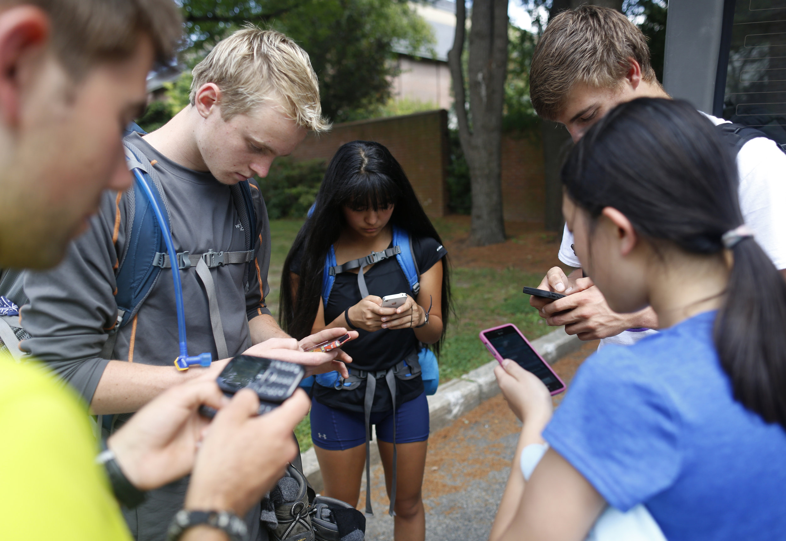 The freshmen exchange numbers upon getting their phones back at the conclusion of the trip.