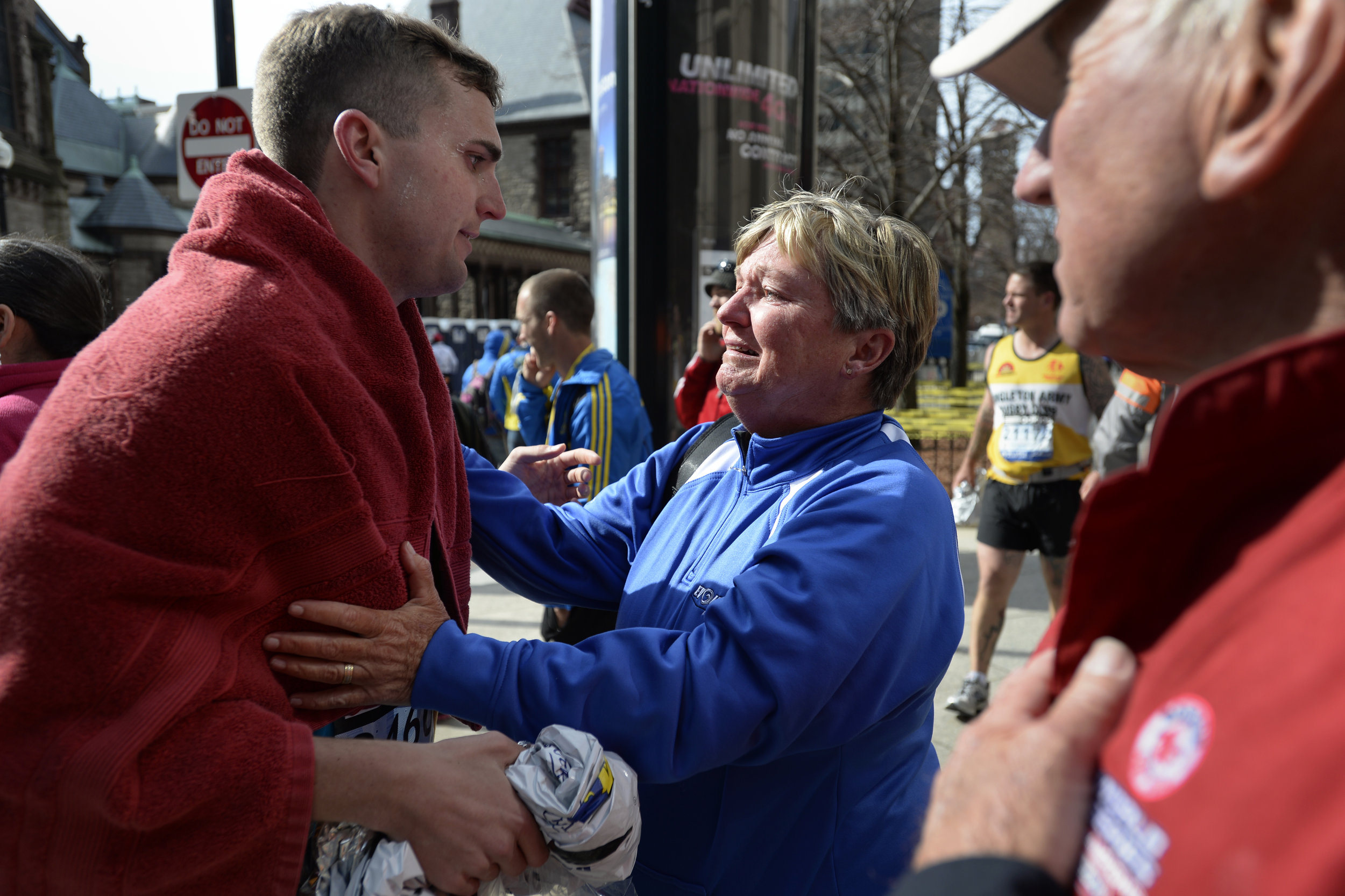 Karen Terry, right, is reunited with Sean Terry after two bombs exploded near the finish line of the Boston Marathon on April 15, 2013.