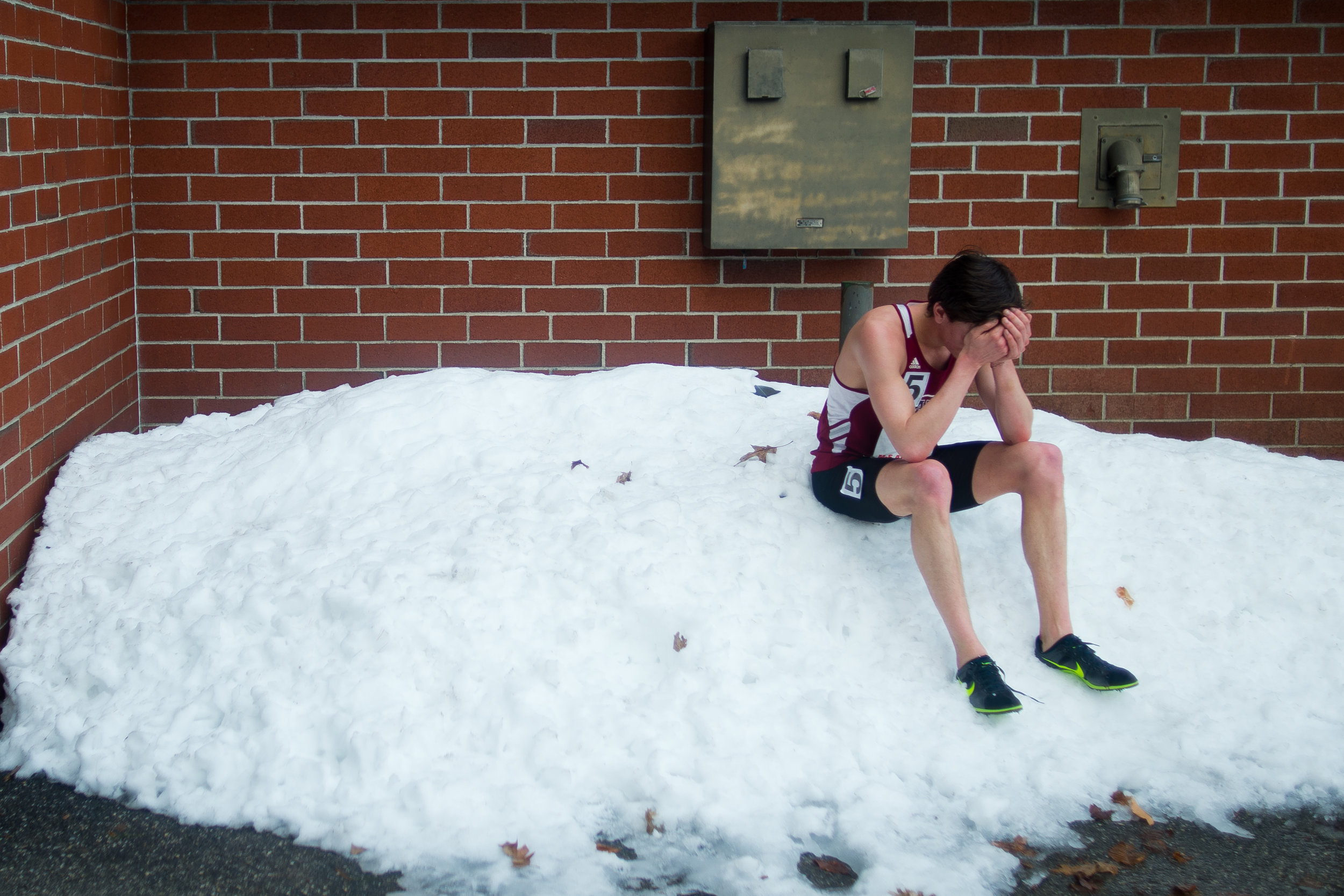 Tully Hannan of Bates College has a solitary moment after competing in the 5,000 meter run at the New England Division III track and field championship on February 16, 2013.