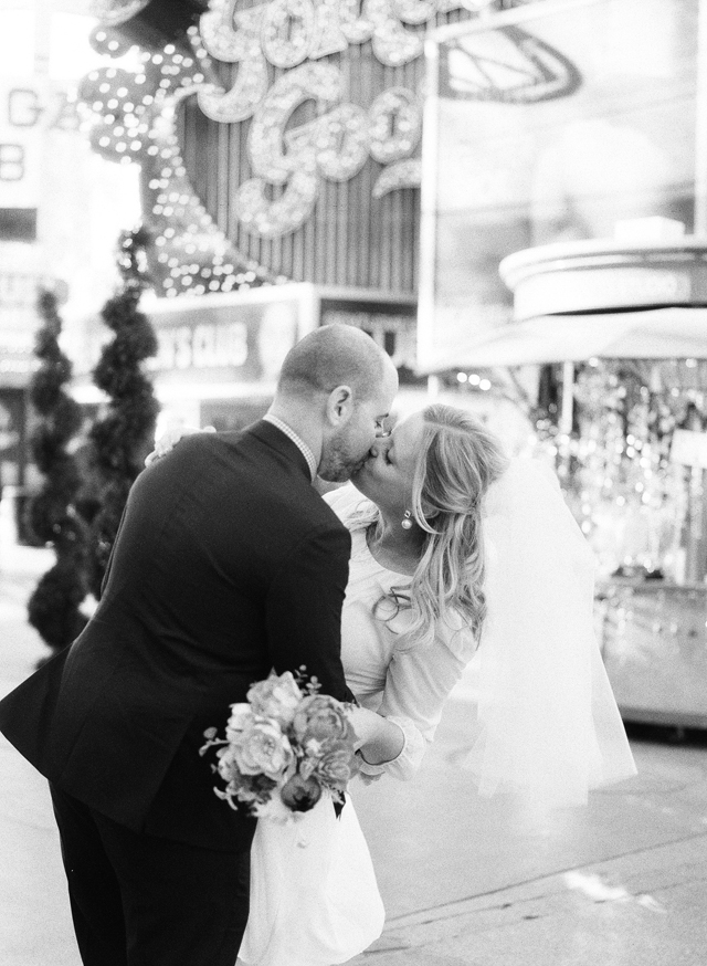 27-bride-groom-kiss-fremont-street-classic-romantic.jpg