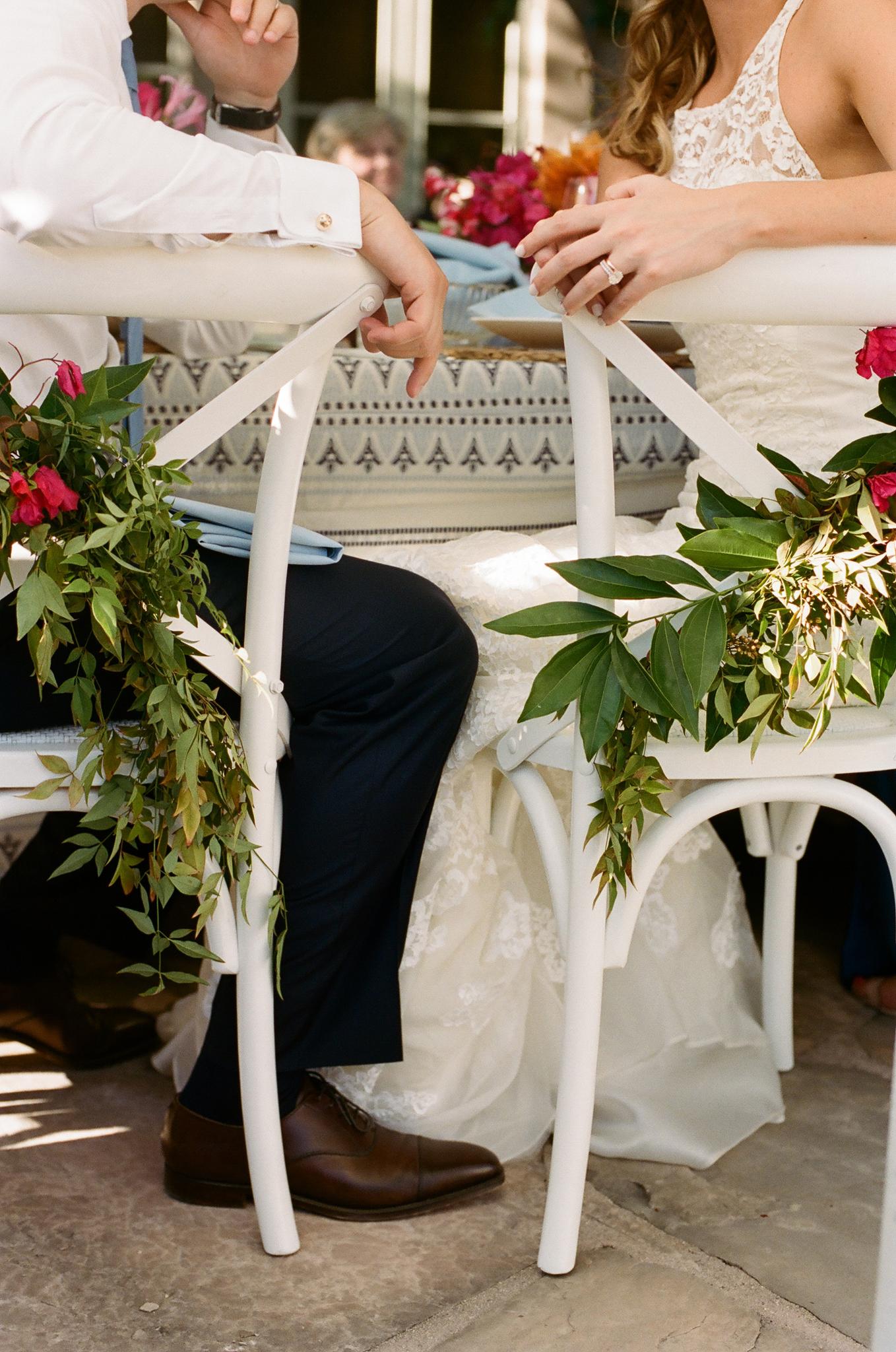 38-bride-groom-white-chair.jpg