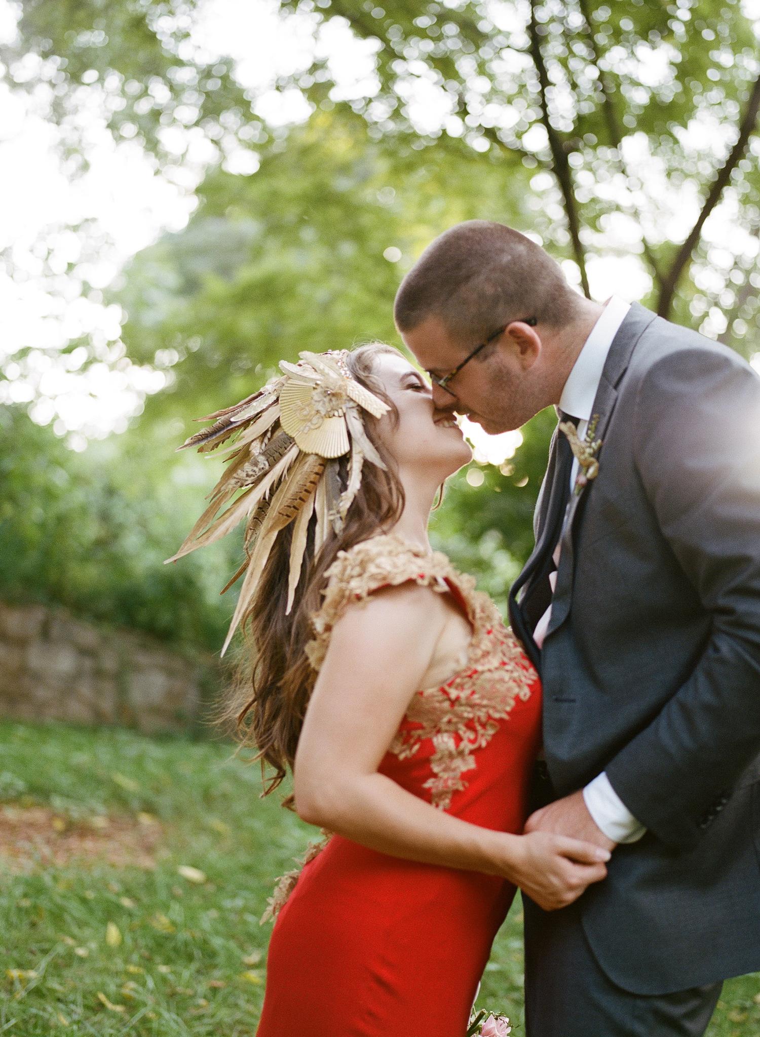 29-bride-groom-kiss-red-dress.jpg