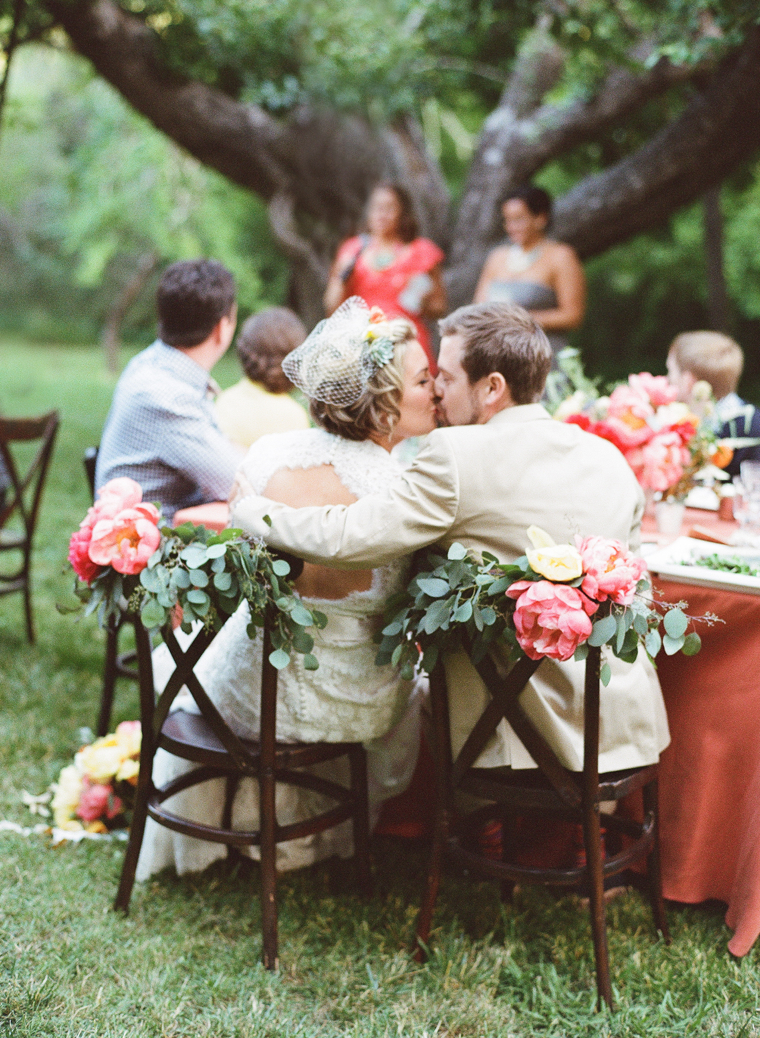 50-bride-groom-kiss-reception.jpg