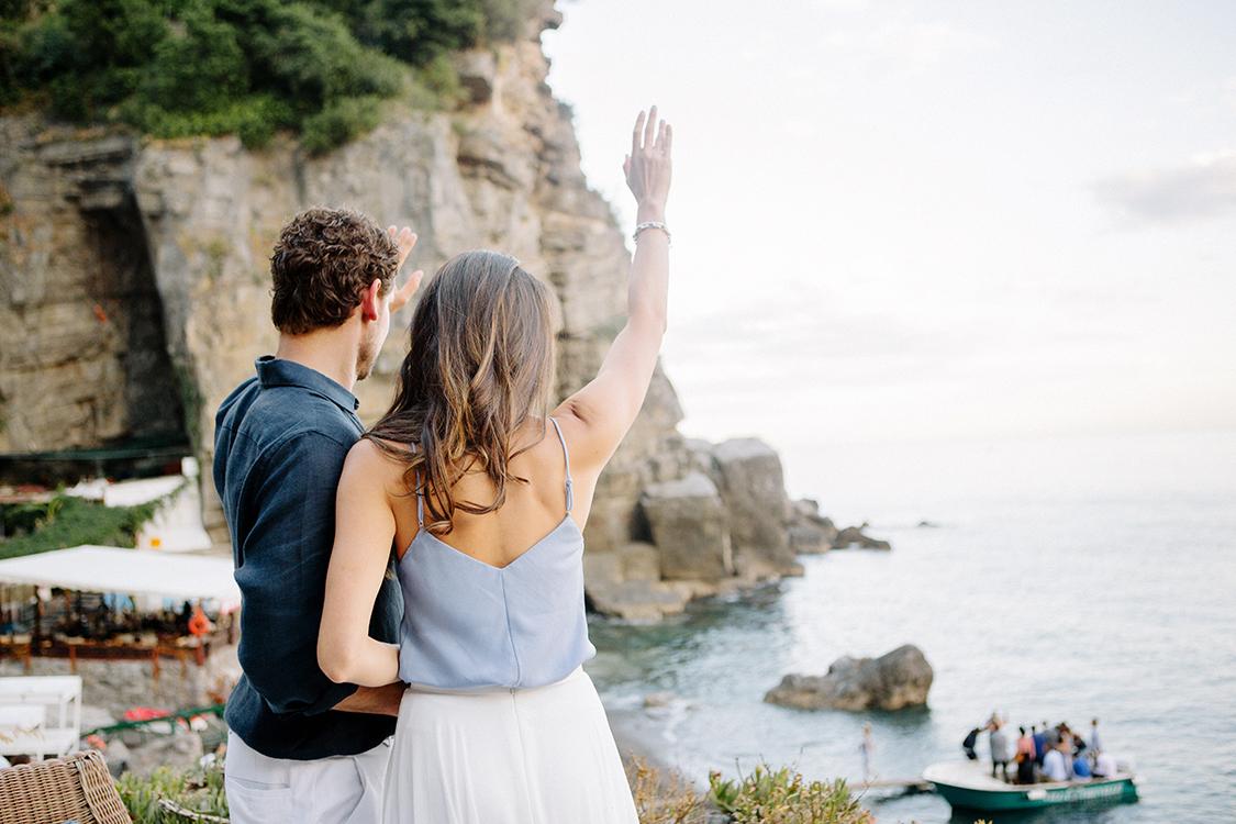 14-couple-waving-guests.jpg