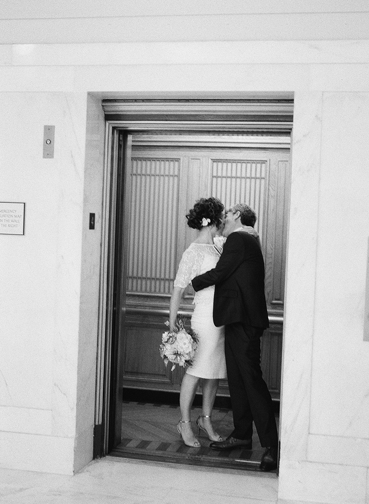 32-bride-groom-kiss-elevator.jpg