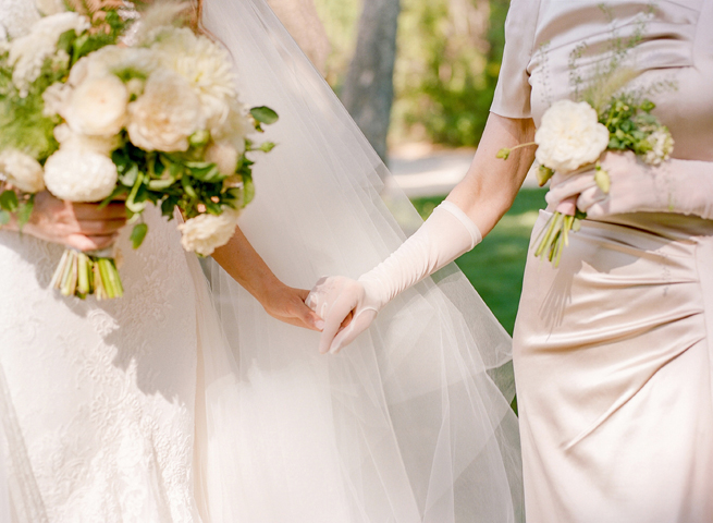 2-mother-bride-holding-hands.jpg