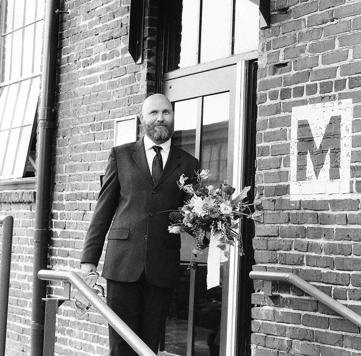 22-man-holding-bouquet.jpg