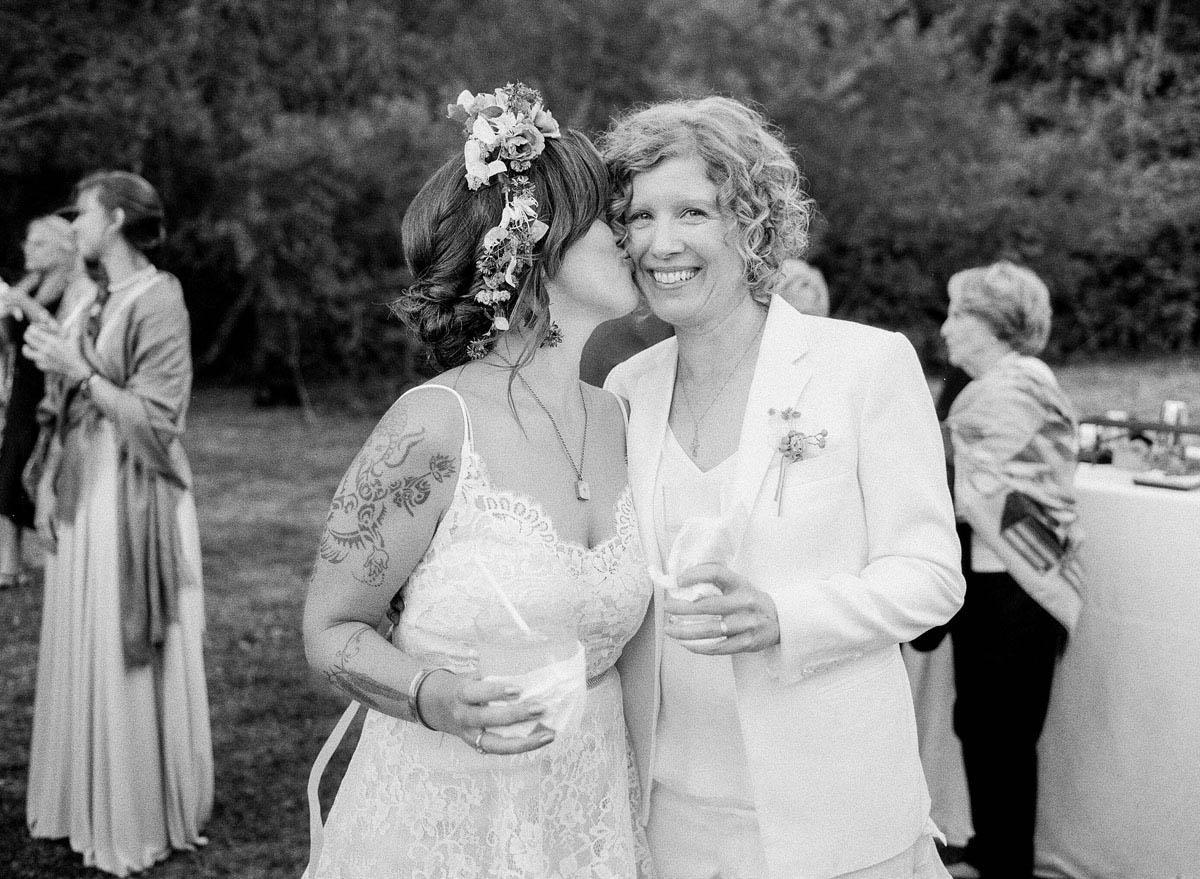 21-bride-kisses-brides-cheek.jpg