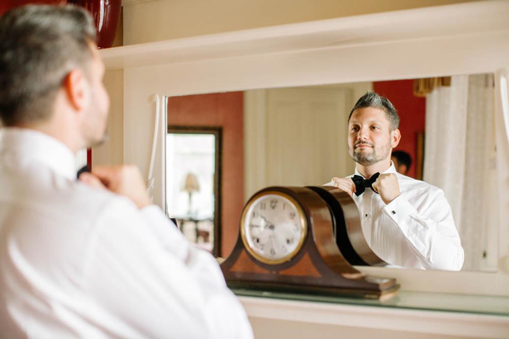 12-groom-tying-bow-tie.jpg