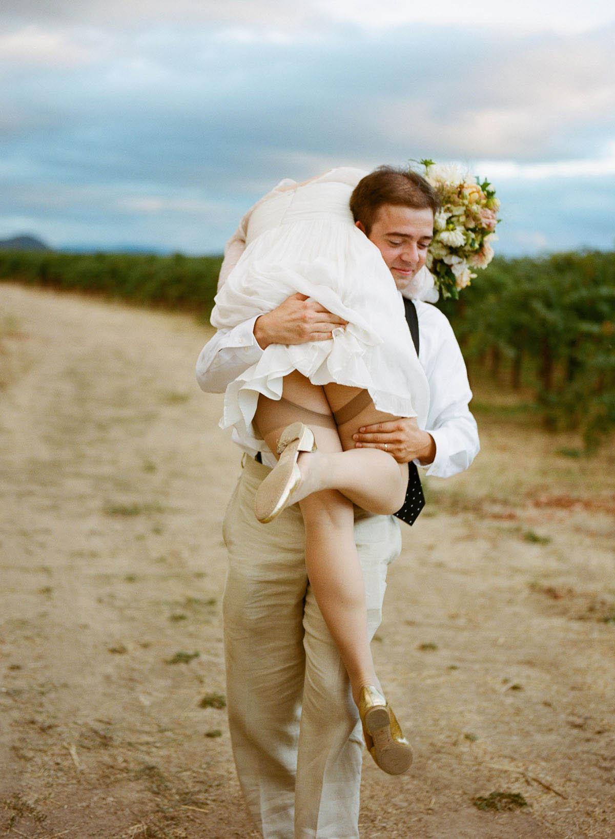 4-groom-carries-bride-shoulder.jpg