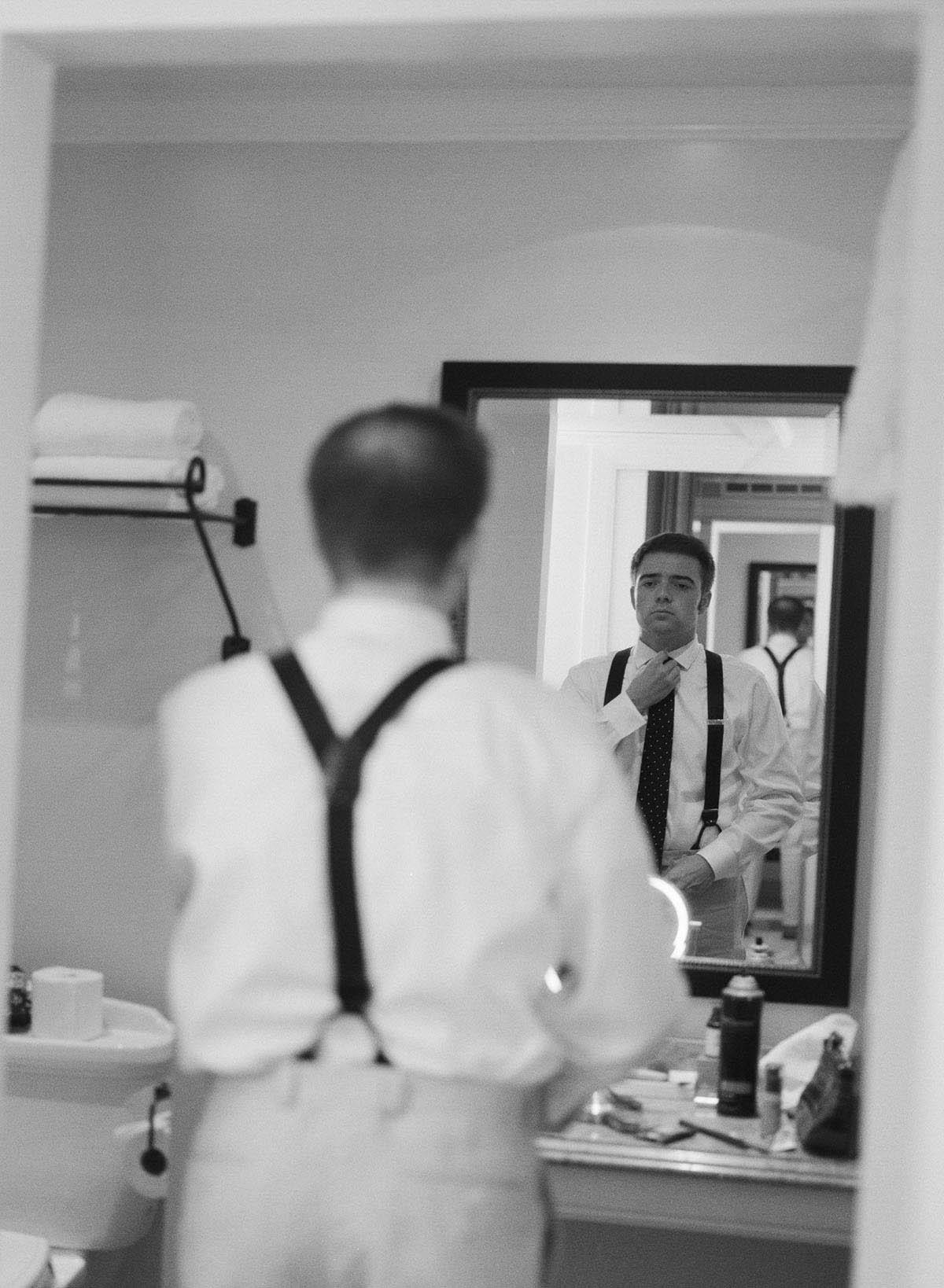 24-groom-suspenders-getting-ready.jpg