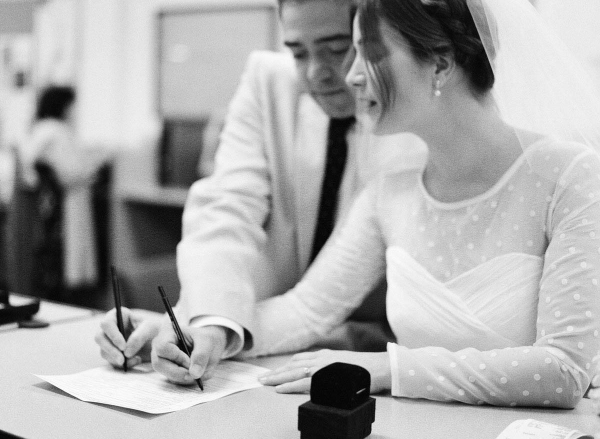 32-bride-groom-sign-wedding-license.jpg