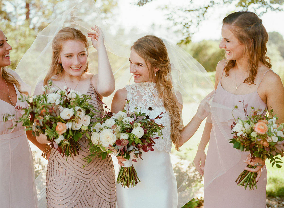 6-bridesmaids-laughing-fishtail-braid.jpg
