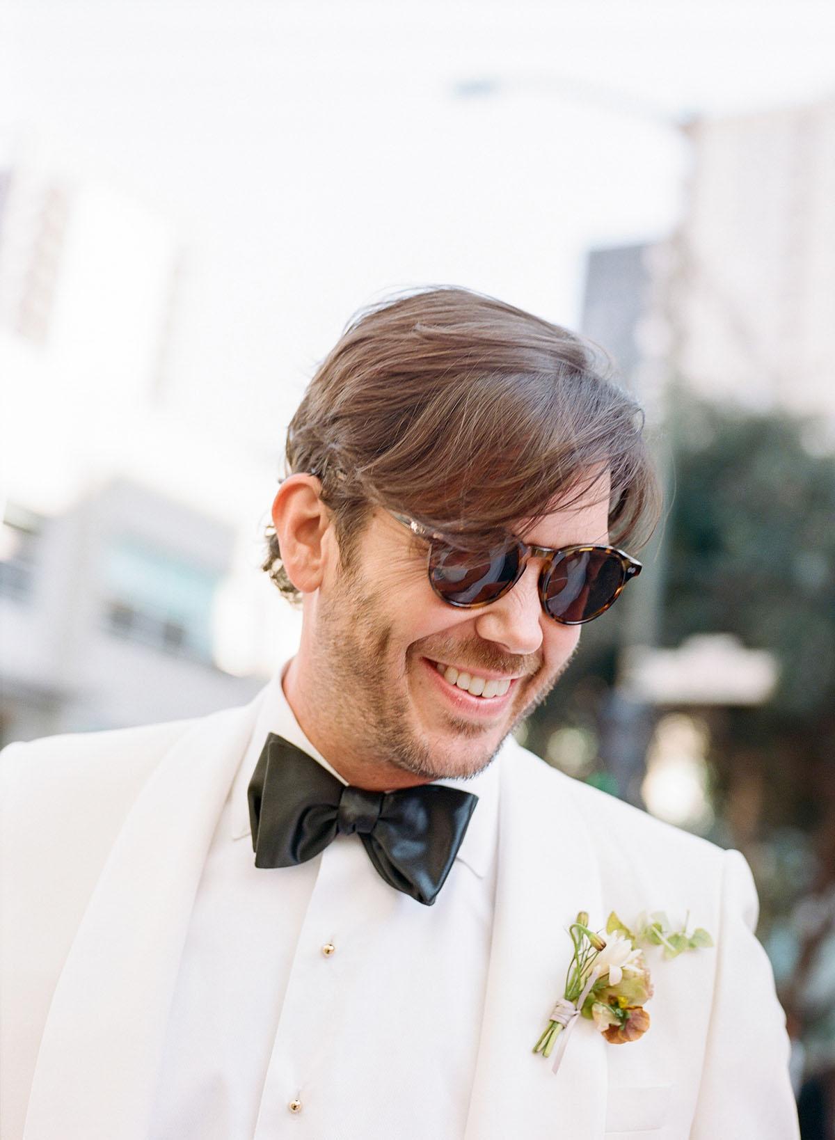 18-groom-white-tuxedo.jpg