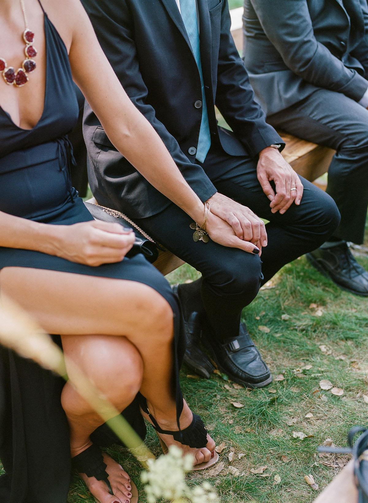 16-couple-holding-hands-ceremony.jpg