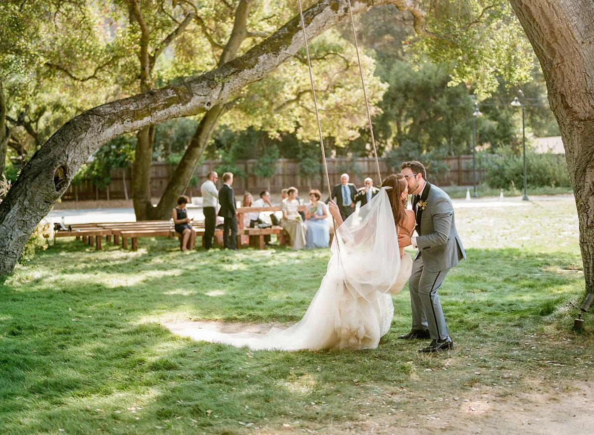 27-bride-groom-swing-kiss.jpg