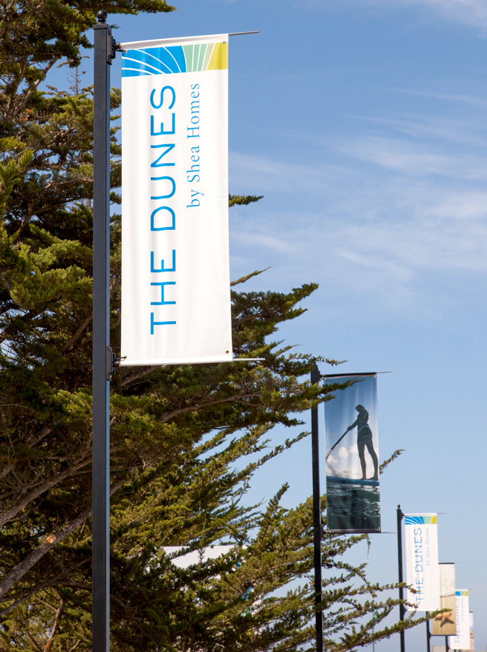 Street pole banner advertisement for The Dunes