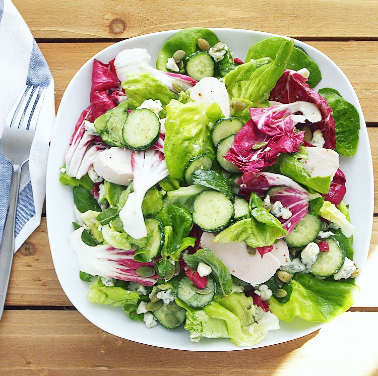 Tips for making an easy salad like this one with butter lettuce, radicchio, mint, cucumber, blue cheese, and mustard vinaigrette.