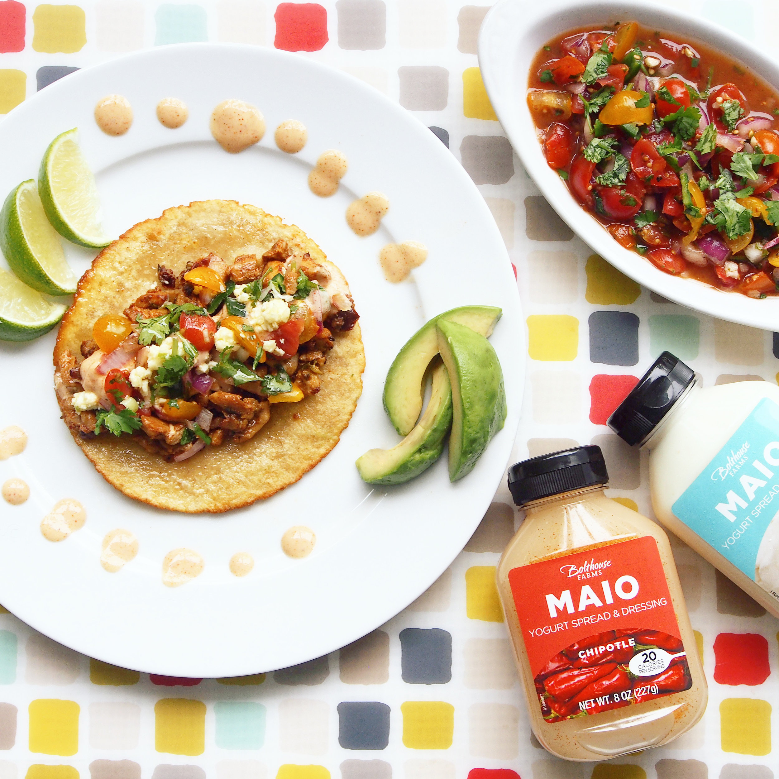 These Spicy Chicken Tacos are made with chipotle chilies with Bolthouse Farm's MAIO Chipotle Yogurt Spread.