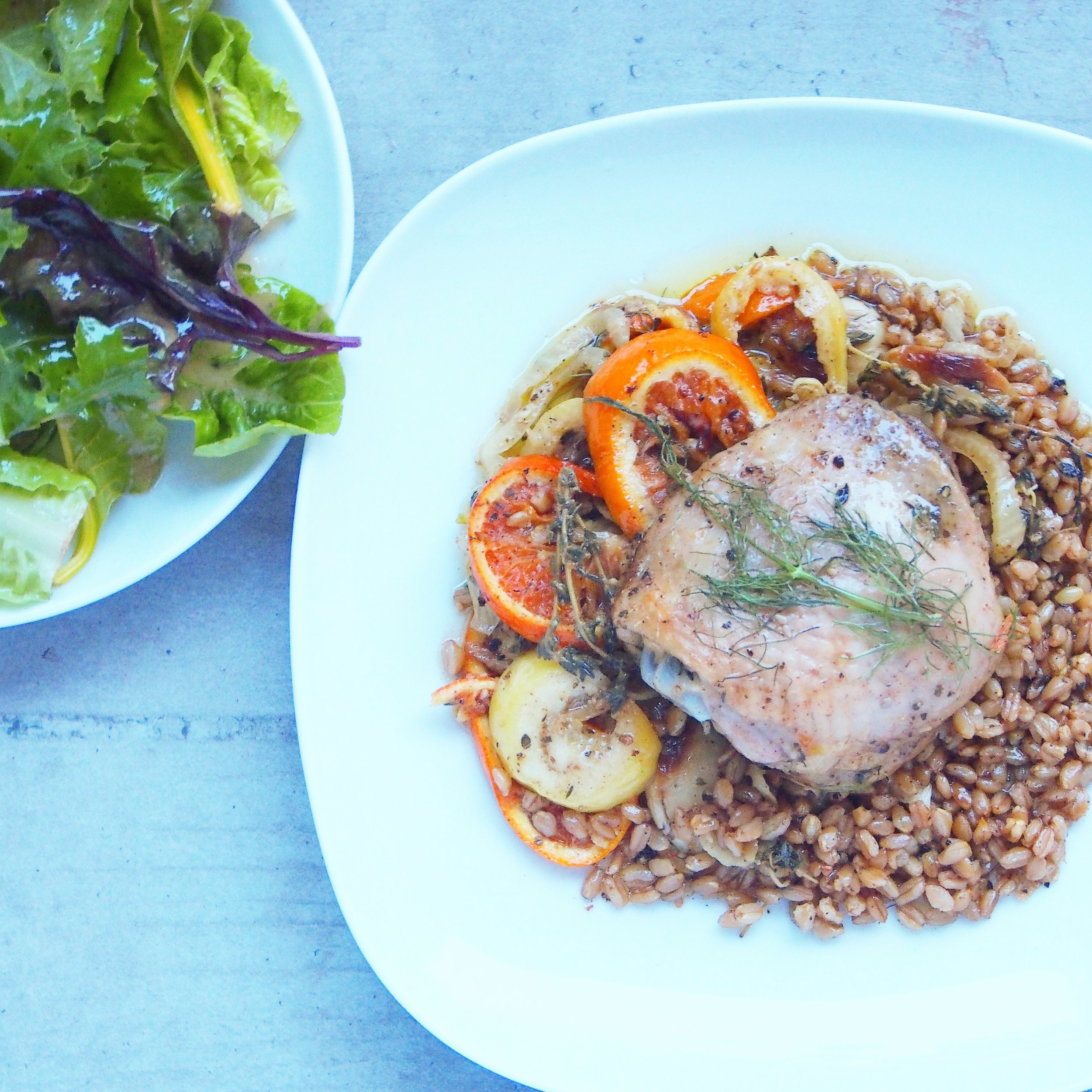 This chicken is served with oranges, lemons, and farro. Served with a simple side salad.