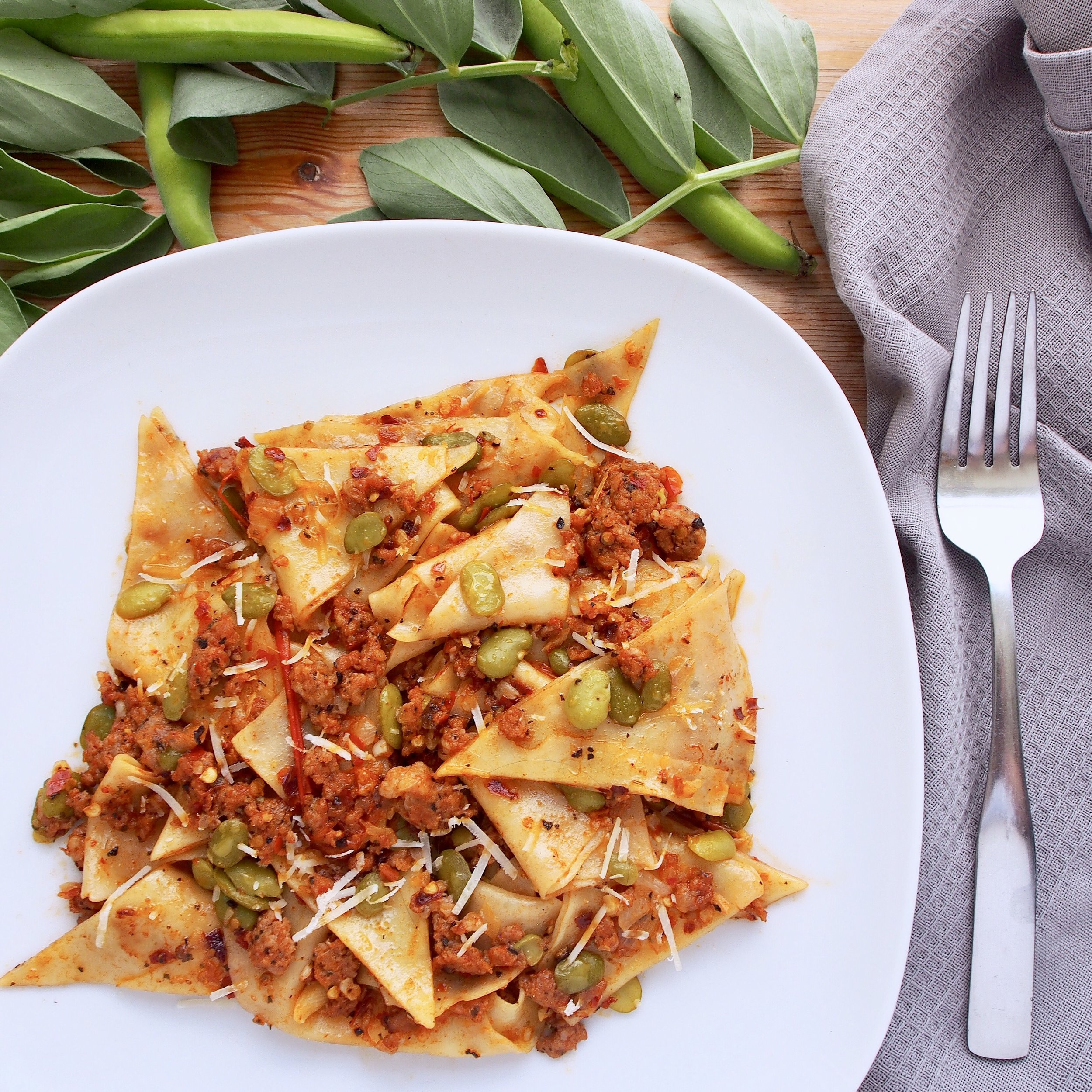 This fava bean pasta is cooked with fresh tomatoes, sausage, and fresh pasta sheets! Fava beans are also known as broad beans and are very tasty in pasta!