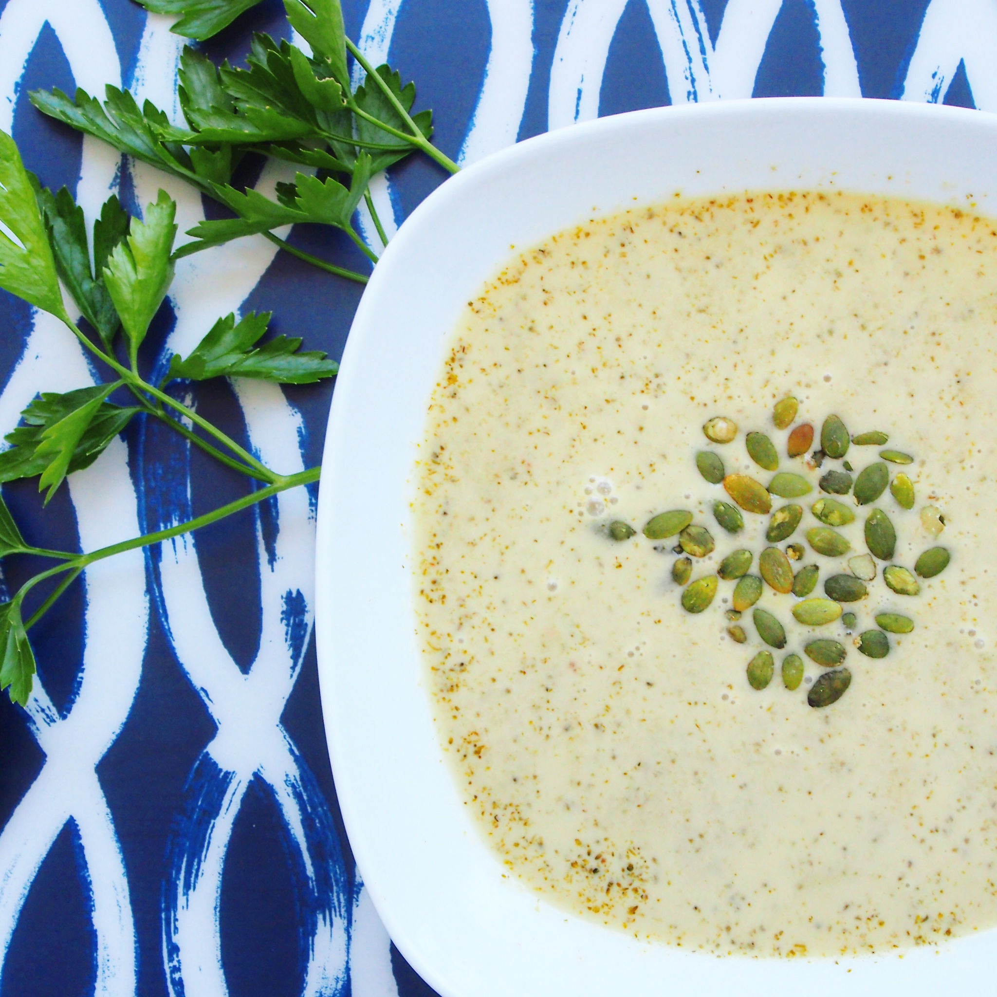This roasted broccoli soup with spiced pepitas will warm you up on a cool night! The flavors from the roasted broccoli are enough to satisfy your appetite, but the spiced pepita recipe also adds a depth to the broccoli soup that is sure to comfort you when it's cold outside!