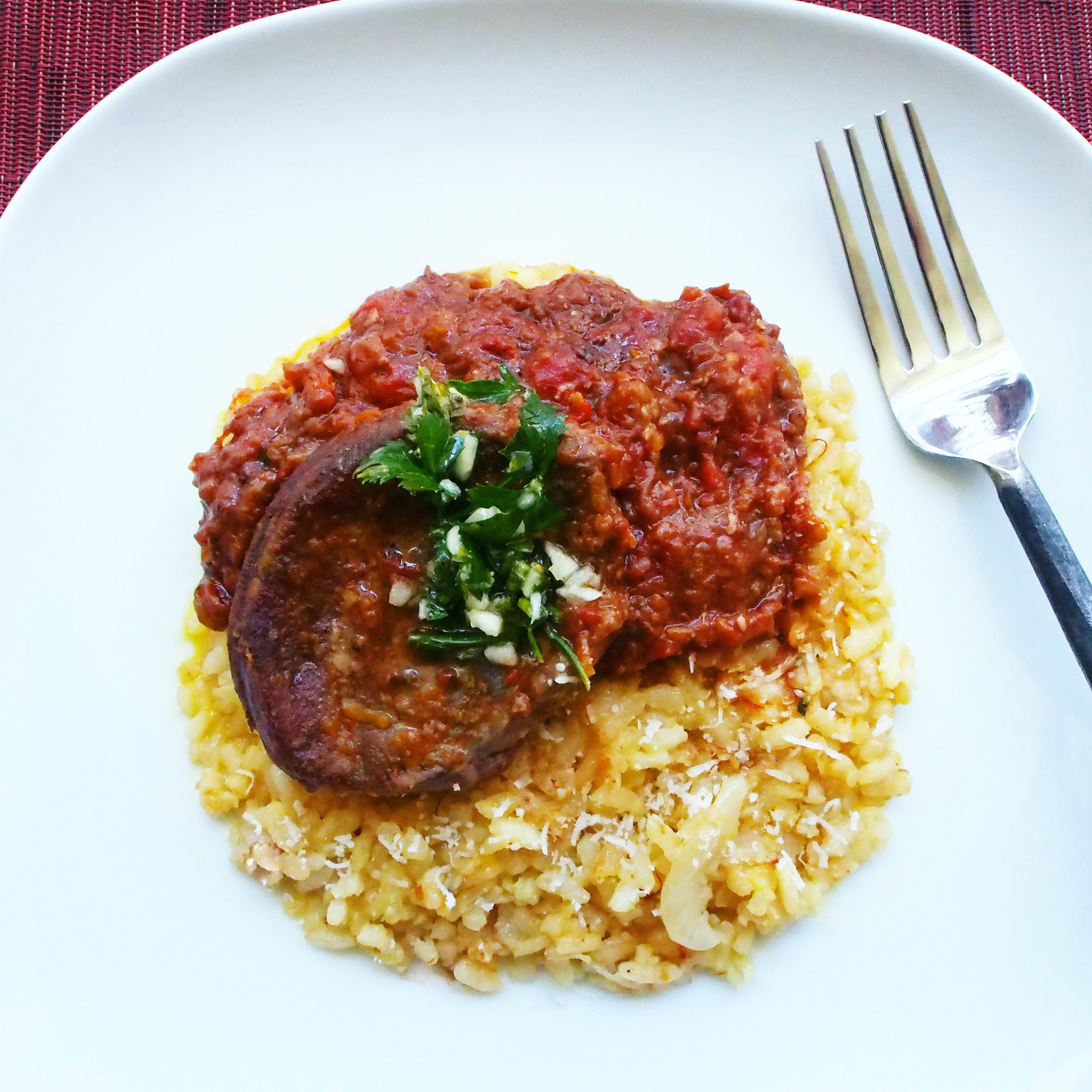 This is a traditional Italian Osso Bucco recipe. Served over a bed of milanese risotto, it's not only an authentic Italian meal, but is super delicious. An easy recipe with simple instructions to follow, you'll mostly just sit around while the ingredients transform into delicious flavors!